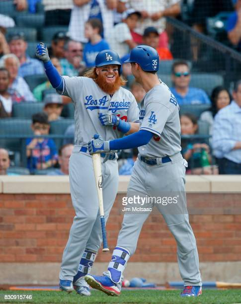 Justin Turner and Cody Bellinger of the Los Angeles Dodgers in action against the New York Mets at Citi Field on August 5 2017 in the Flushing...