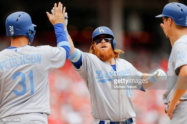 Justin Turner celebrates with Joc Pederson and Corey Seager after hitting a threerun home run in the sixth inning against the Cincinnati Reds at...