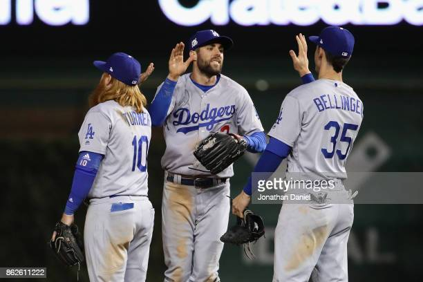 Justin Turner Chris Taylor and Cody Bellinger of the Los Angeles Dodgers celebrate after beating the Chicago Cubs 61 during game three of the...