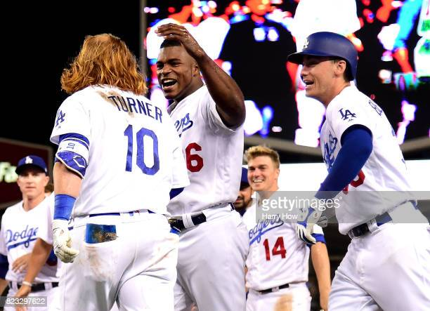 Justin Turner of the Los Angeles Dodger celebrates his game winning single with Yasiel Puig and Cody Bellinger for a 65 win over the Minnesota Twins...