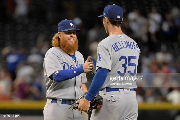 Justin Turner of the Los Angeles Dodgers and Cody Bellinger celebrate after closing out the game against the Arizona Diamondbacks at Chase Field on...
