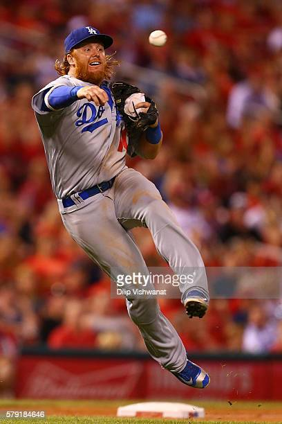 Justin Turner of the Los Angeles Dodgers attempts to throw a runner out against the St Louis Cardinals in the seventh inning at Busch Stadium on July...