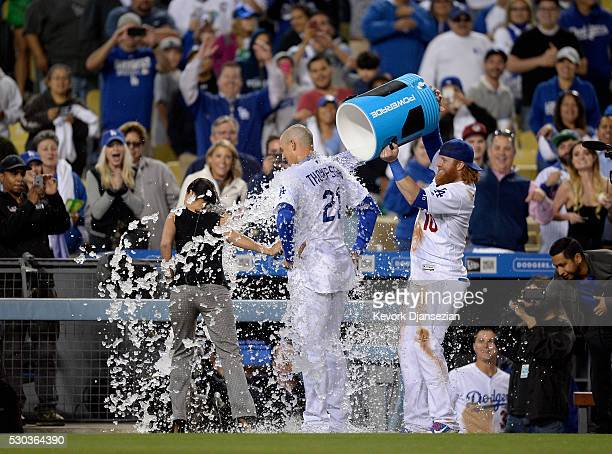 Justin Turner of the Los Angeles Dodgers celebrate as he pours ice water on Trayce Thompson of the Los Angeles Dodgers after he it the game winning...