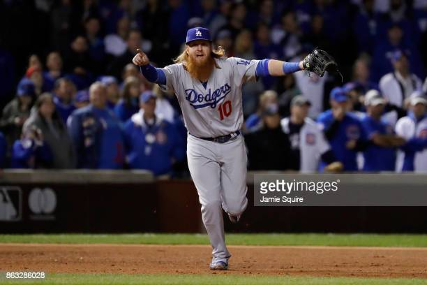 Justin Turner of the Los Angeles Dodgers celebrates after beating the Chicago Cubs 111 in game five of the National League Championship Series at...