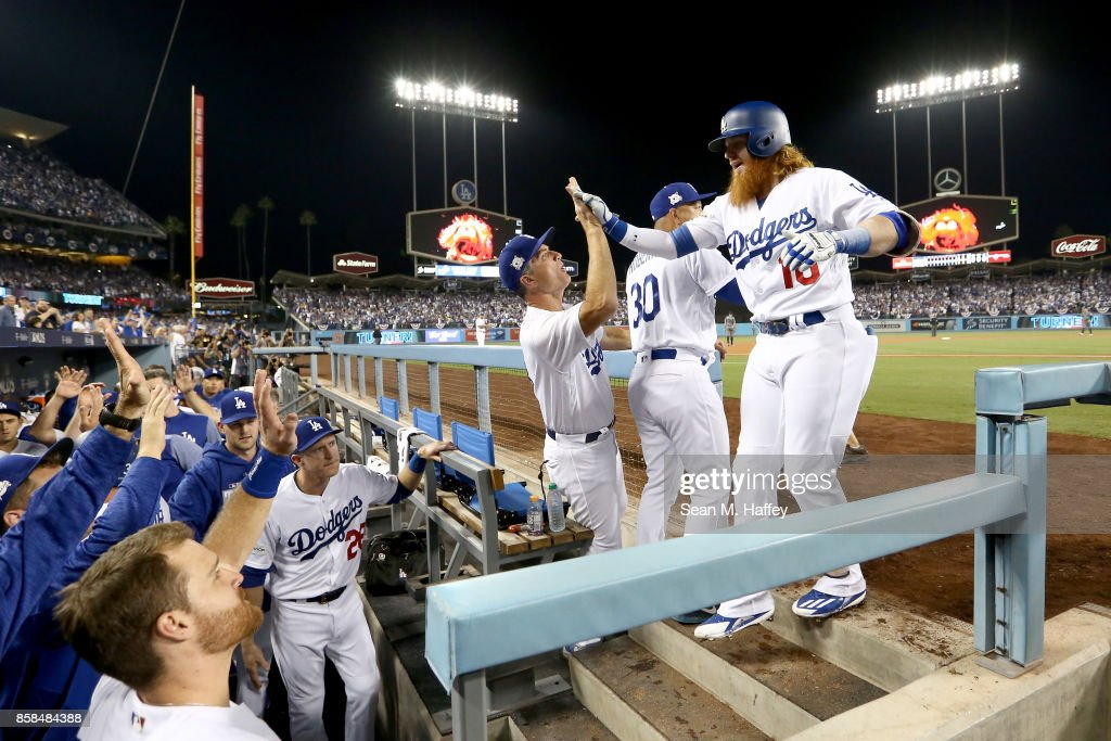 Justin Turner #10 of the Los Angeles Dodgers celebrates after he hits a three-run home run in the first inning against the Arizona Diamondbacks in game one of the National League Division Series at Dodger Stadium on October 6, 2017 in Los Angeles, California.
