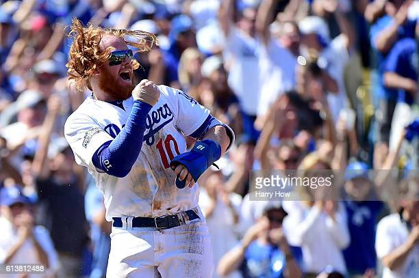 Justin Turner of the Los Angeles Dodgers celebrates after scoring a run in the first inning against the Washington Nationals in game three of the...