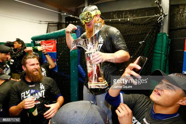Justin Turner of the Los Angeles Dodgers celebrates in the clubhouse after defeating the Chicago Cubs 111 in game five of the National League...