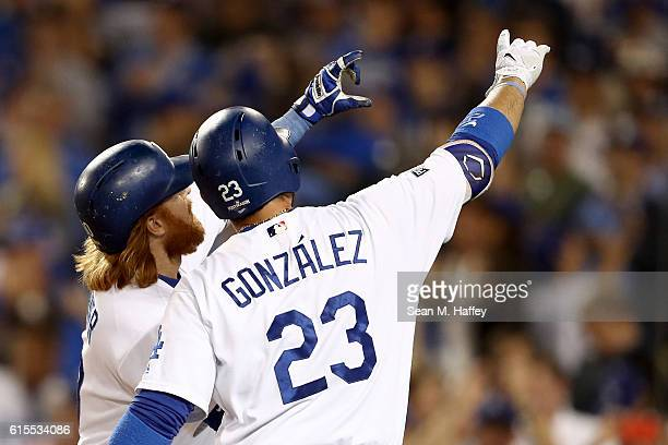 Justin Turner of the Los Angeles Dodgers celebrates with Adrian Gonzalez after Turner hits a solo home run in the sixth inning against the Chicago...
