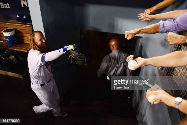 Justin Turner of the Los Angeles Dodgers celebrates with fans after hitting a threerun walkoff home run in the ninth inning to defeat the Chicago...