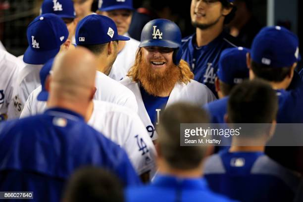 Justin Turner of the Los Angeles Dodgers celebrates with teammates in the dugout after hitting a tworun home run during the sixth inning against the...