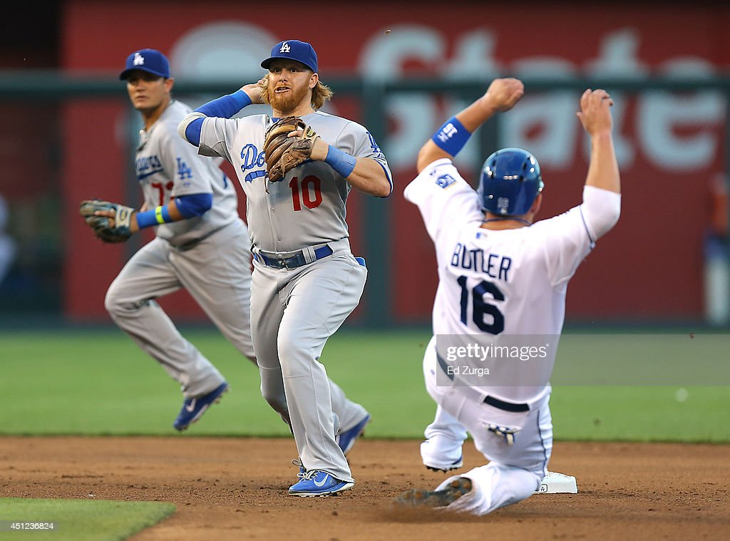 <a gi-track='captionPersonalityLinkClicked' href=/galleries/search?phrase=Justin+Turner&family=editorial&specificpeople=550296 ng-click='$event.stopPropagation()'>Justin Turner</a> #10 of the Los Angeles Dodgers gets the force out on <a gi-track='captionPersonalityLinkClicked' href=/galleries/search?phrase=Billy+Butler&family=editorial&specificpeople=759092 ng-click='$event.stopPropagation()'>Billy Butler</a> #16 of the Kansas City Royals and throws to first on a double play attempt in the fourth inning at Kauffman Stadium on June 25, 2014 in Kansas City, Missouri. Alex Gordon was safe at first on the play.