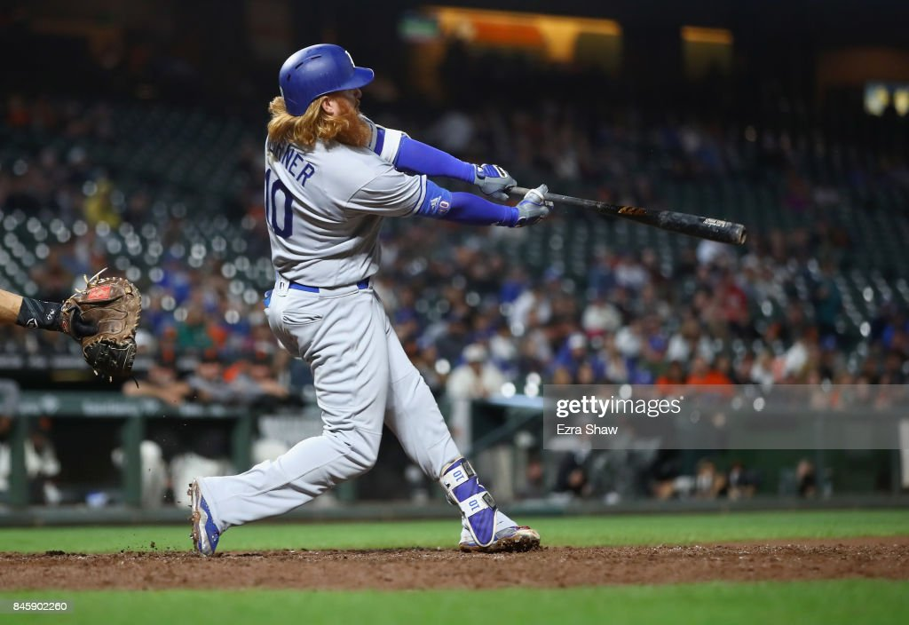 Justin Turner #10 of the Los Angeles Dodgers hits a double that scored Corey Seager #5 in the sixth inning against the San Francisco Giants at AT&T Park on September 11, 2017 in San Francisco, California.
