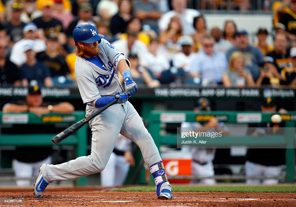 <a gi-track='captionPersonalityLinkClicked' href=/galleries/search?phrase=Justin+Turner&family=editorial&specificpeople=550296 ng-click='$event.stopPropagation()'>Justin Turner</a> #10 of the Los Angeles Dodgers hits a RBI double in the third inning during the game against the Pittsburgh Pirates at PNC Park on June 24, 2016 in Pittsburgh, Pennsylvania.