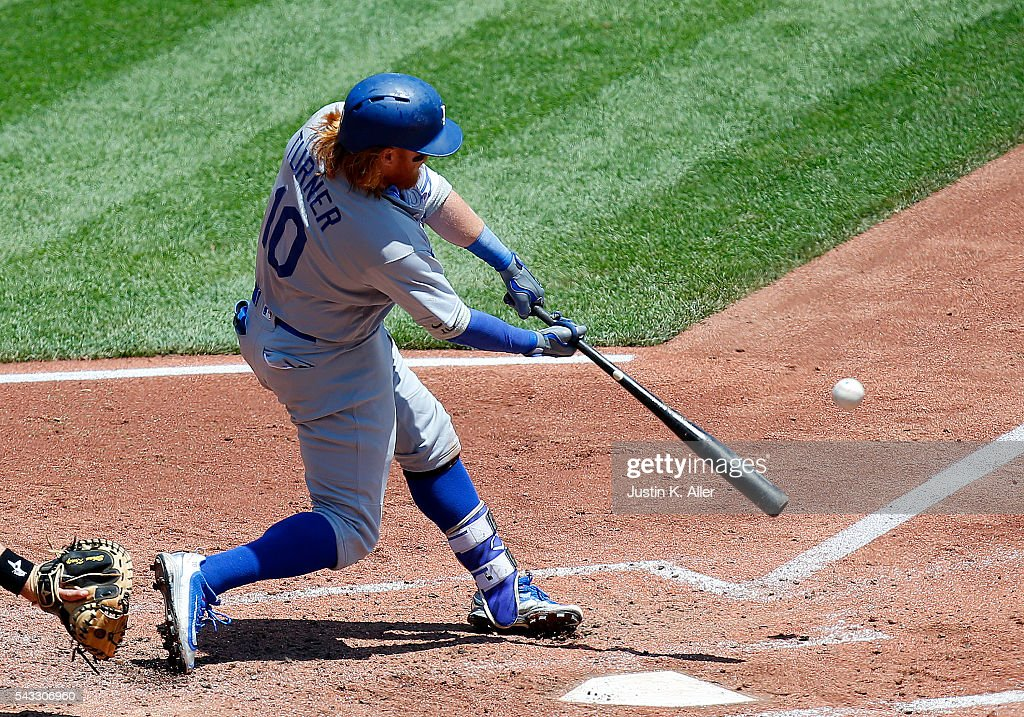 <a gi-track='captionPersonalityLinkClicked' href=/galleries/search?phrase=Justin+Turner&family=editorial&specificpeople=550296 ng-click='$event.stopPropagation()'>Justin Turner</a> #10 of the Los Angeles Dodgers hits a sacrifice in the third inning during the game against the Pittsburgh Pirates at PNC Park on June 27, 2016 in Pittsburgh, Pennsylvania.