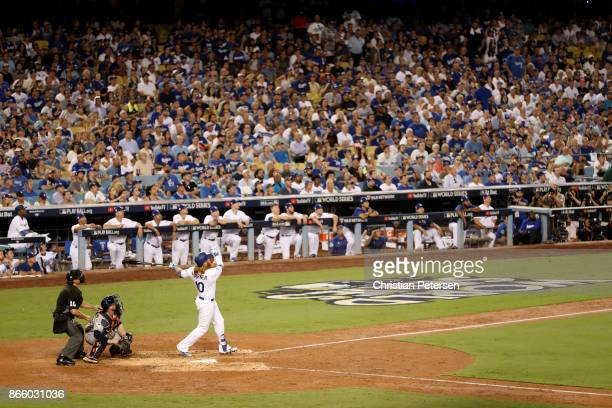 Justin Turner of the Los Angeles Dodgers hits a tworun home run during the sixth inning against the Houston Astros in game one of the 2017 World...
