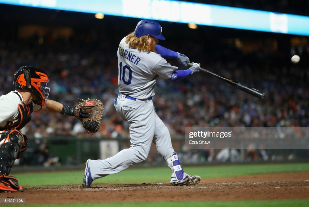 Justin Turner #10 of the Los Angeles Dodgers hits an RBI double in the eighth inning against the San Francisco Giants at AT&T Park on September 12, 2017 in San Francisco, California.