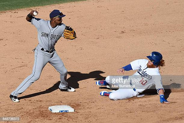 Justin Turner of the Los Angeles Dodgers is an out at second base in the fifth inning against Alexei Ramirez of the San Diego Padres at Dodger...
