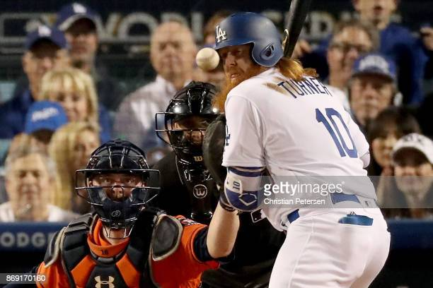 Justin Turner of the Los Angeles Dodgers is hit by a pitch during the third inning against the Houston Astros in game seven of the 2017 World Series...
