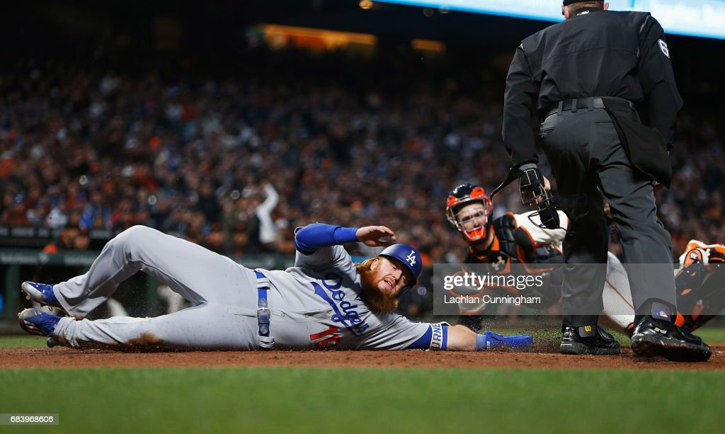 Justin Turner #10 of the Los Angeles Dodgers is tagged out at home plate by catcher Buster Posey #28 of the San Francisco Giants at AT&T Park on May 16, 2017 in San Francisco, California.