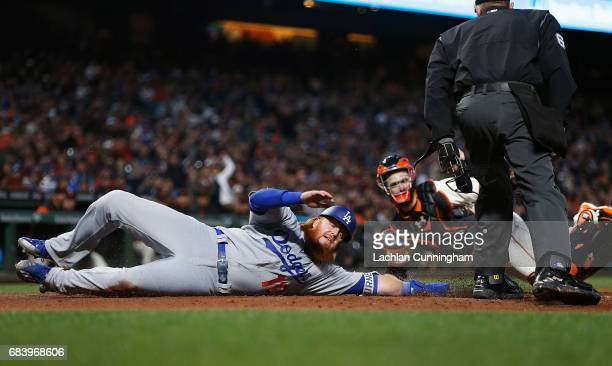 Justin Turner of the Los Angeles Dodgers is tagged out at home plate by catcher Buster Posey of the San Francisco Giants at ATT Park on May 16 2017...