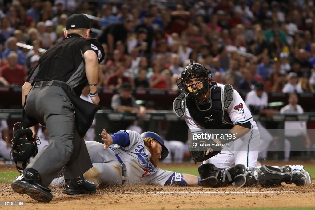 Justin Turner #10 of the Los Angeles Dodgers is tagged out by catcher Jeff Mathis #2 of the Arizona Diamondbacks as he attempts to score during the fourth inning of the MLB game at Chase Field on April 21, 2017 in Phoenix, Arizona.