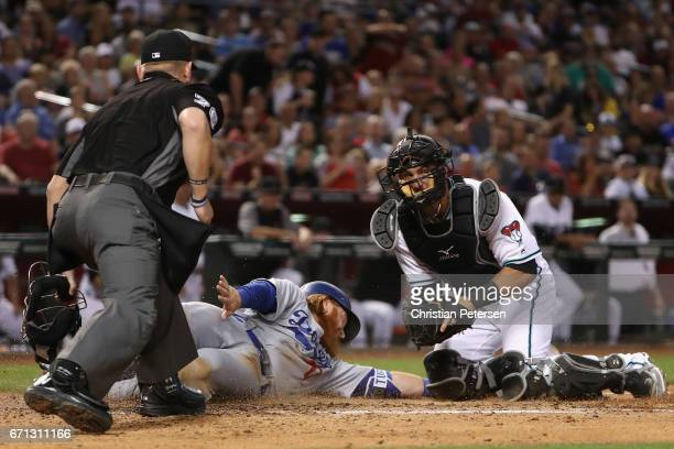 Justin Turner of the Los Angeles Dodgers is tagged out by catcher Jeff Mathis of the Arizona Diamondbacks as he attempts to score during the fourth...
