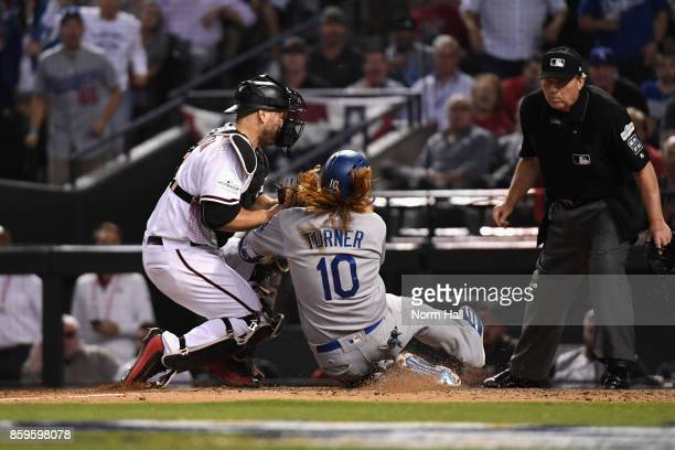 Justin Turner of the Los Angeles Dodgers is tagged out by Chris Iannetta of the Arizona Diamondbacks during the ninth inning of the National League...
