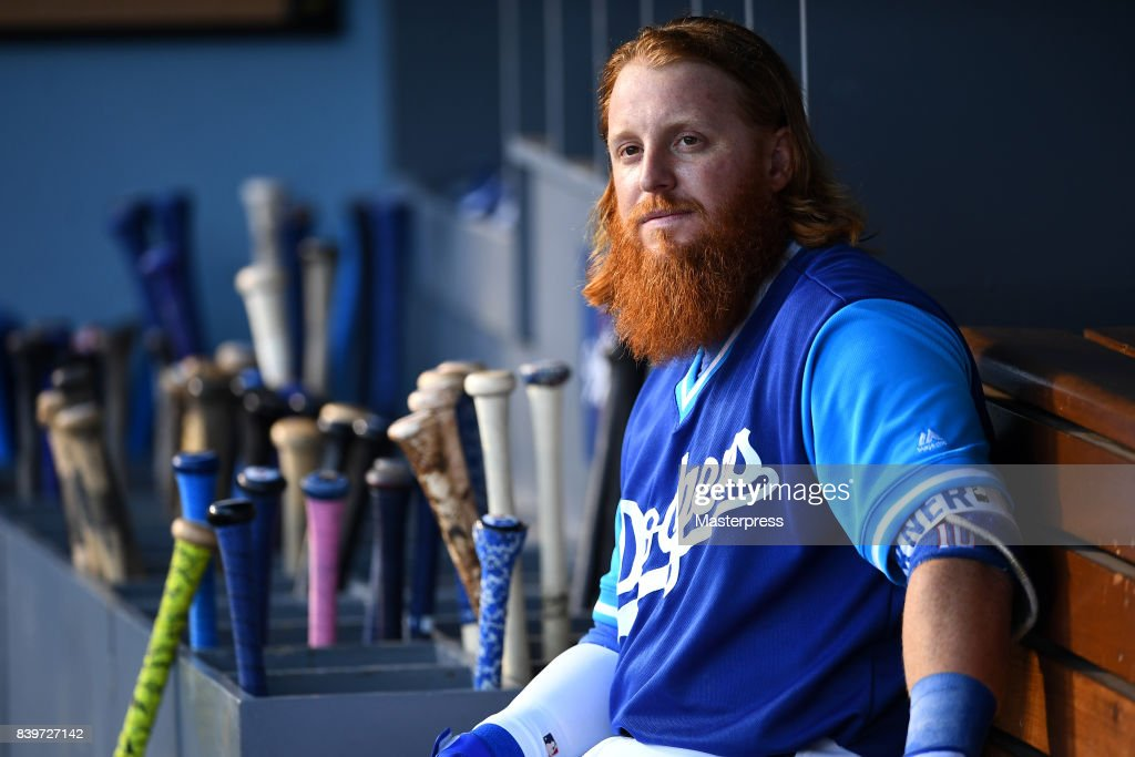 Justin Turner #10 of the Los Angeles Dodgers looks on during the game against the Milwaukee Brewers at Dodger Stadium on August 26, 2017 in Los Angeles, California.