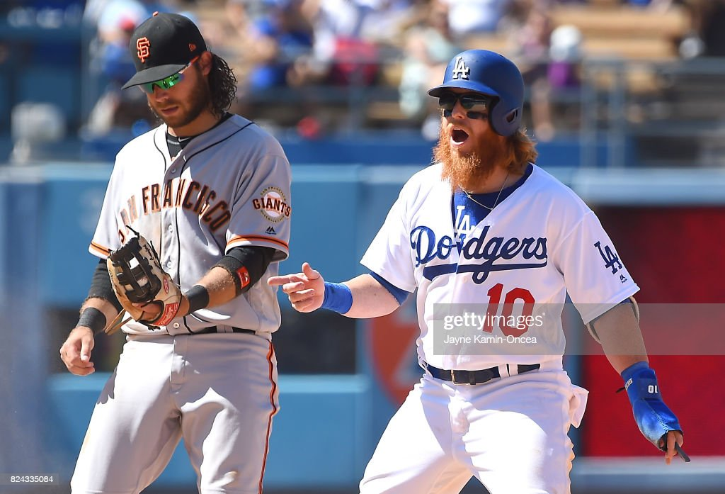 Justin Turner #10 of the Los Angeles Dodgers reacts after he was tagged out at second base on an attempted steal by Brandon Crawford #35 of the San Francisco Giants in the eighth inning at Dodger Stadium on July 29, 2017 in Los Angeles, California. Los Angeles Dodgers won 2-1.