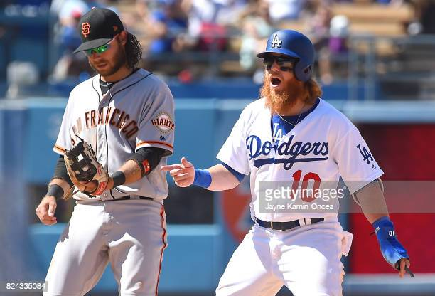 Justin Turner of the Los Angeles Dodgers reacts after he was tagged out at second base on an attempted steal by Brandon Crawford of the San Francisco...