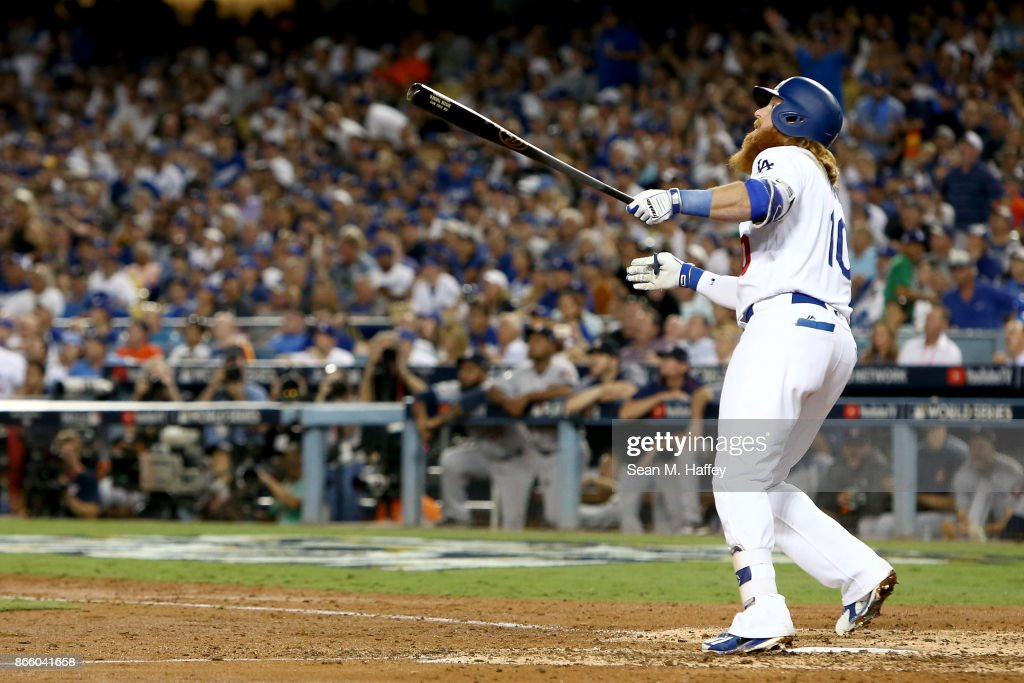 Justin Turner #10 of the Los Angeles Dodgers reacts after hitting a two-run home run during the sixth inning against the Houston Astros in game one of the 2017 World Series at Dodger Stadium on October 24, 2017 in Los Angeles, California.