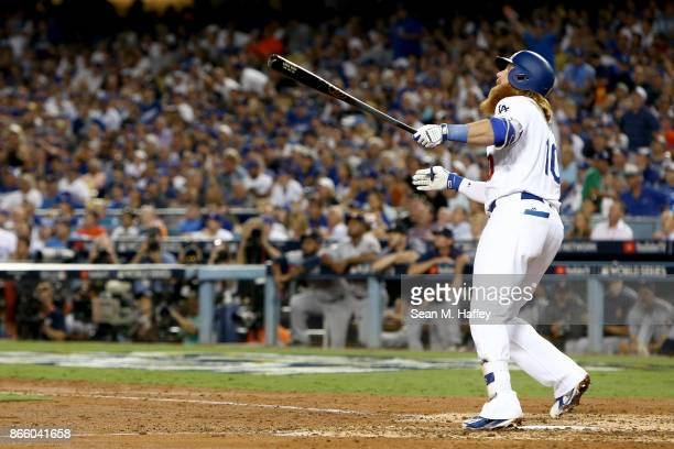 Justin Turner of the Los Angeles Dodgers reacts after hitting a tworun home run during the sixth inning against the Houston Astros in game one of the...