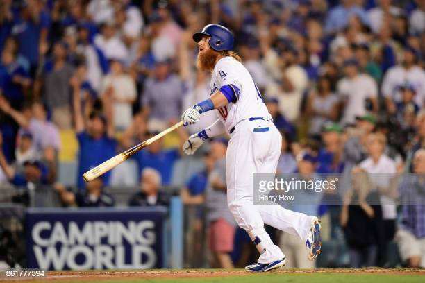 Justin Turner of the Los Angeles Dodgers reacts after hitting a threerun walkoff home run in the ninth inning to defeat the Chicago Cubs 41 in game...