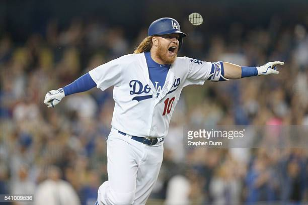 Justin Turner of the Los Angeles Dodgers reacts as he runs to first on his walk off RBI single in the tenth inning at Dodger Stadium on June 17 2016...