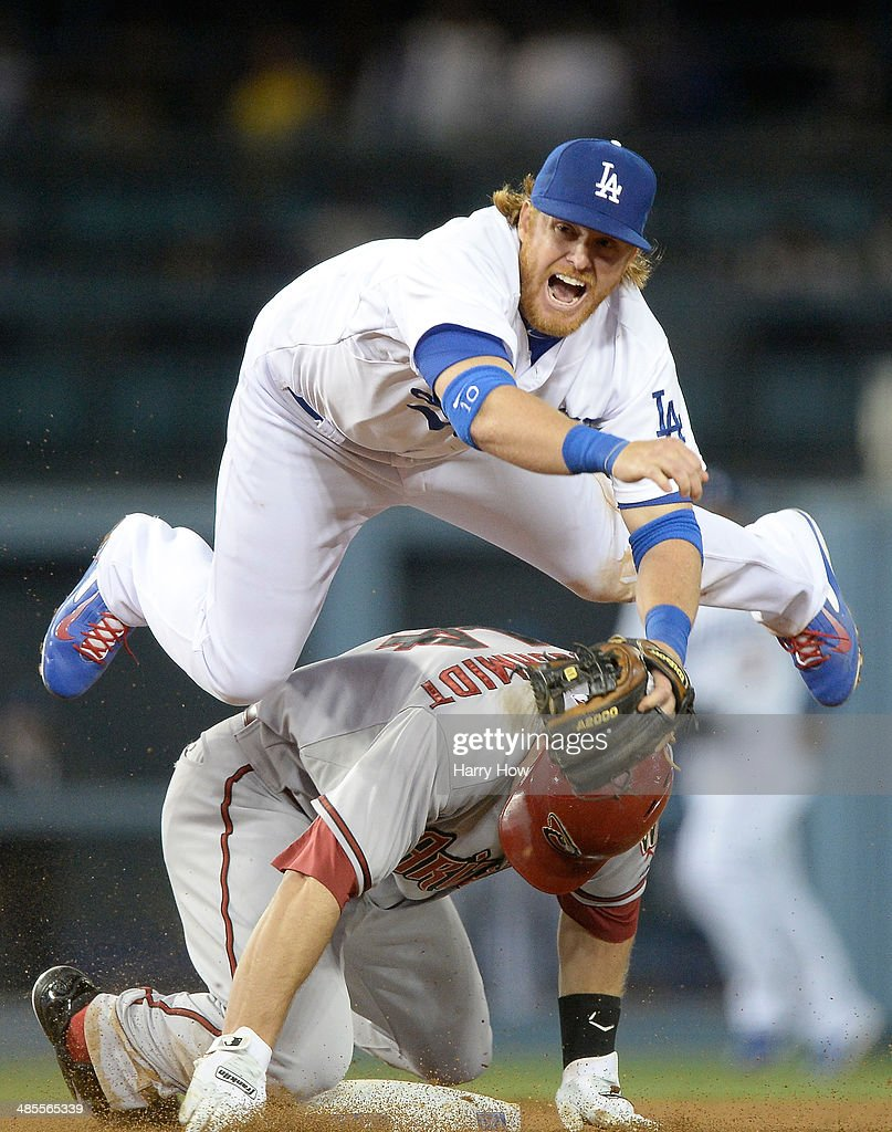 <a gi-track='captionPersonalityLinkClicked' href=/galleries/search?phrase=Justin+Turner&family=editorial&specificpeople=550296 ng-click='$event.stopPropagation()'>Justin Turner</a> #10 of the Los Angeles Dodgers reacts to his throw over <a gi-track='captionPersonalityLinkClicked' href=/galleries/search?phrase=Paul+Goldschmidt&family=editorial&specificpeople=7511120 ng-click='$event.stopPropagation()'>Paul Goldschmidt</a> #44 of the Arizona Diamondbacks for a double play during the 10th inning at Dodger Stadium on April 18, 2014 in Los Angeles, California.