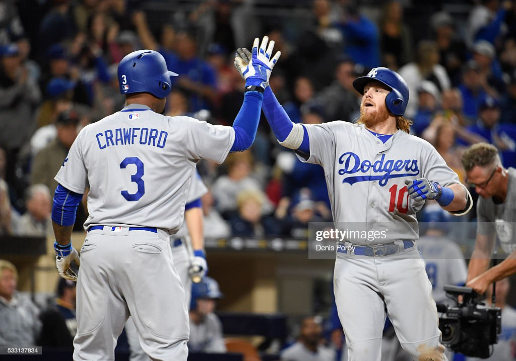 <a gi-track='captionPersonalityLinkClicked' href=/galleries/search?phrase=Justin+Turner&family=editorial&specificpeople=550296 ng-click='$event.stopPropagation()'>Justin Turner</a> #10 of the Los Angeles Dodgers, right, is congratulated by <a gi-track='captionPersonalityLinkClicked' href=/galleries/search?phrase=Carl+Crawford&family=editorial&specificpeople=208074 ng-click='$event.stopPropagation()'>Carl Crawford</a> #3 after hitting a two-run home run during the eighth inning of a baseball game against the San Diego Padres at PETCO Park on May 20, 2016 in San Diego, California.