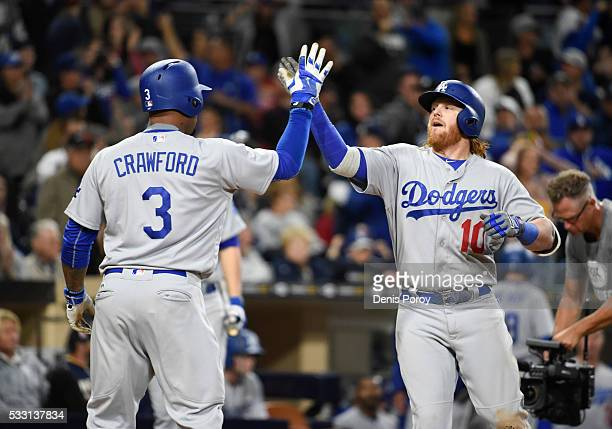 Justin Turner of the Los Angeles Dodgers right is congratulated by Carl Crawford after hitting a tworun home run during the eighth inning of a...
