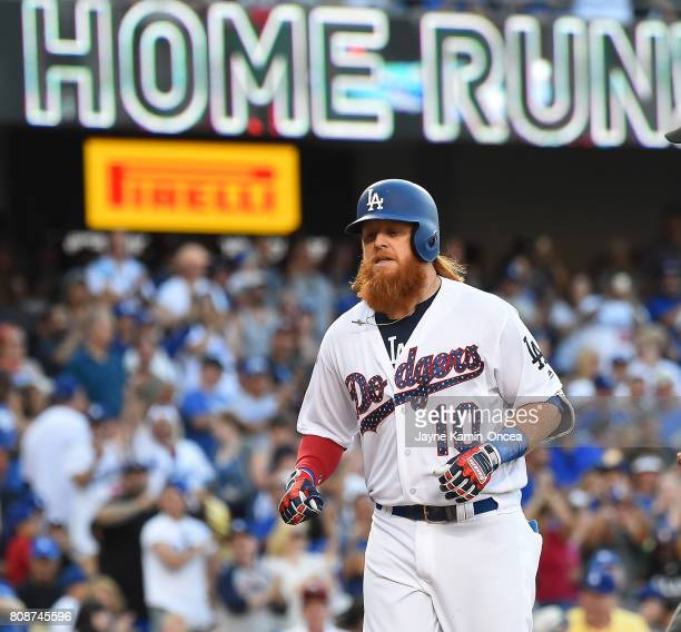 Justin Turner of the Los Angeles Dodgers rounds the bases after a solo home run in the third inning against the Arizona Diamondbacks at Dodger...