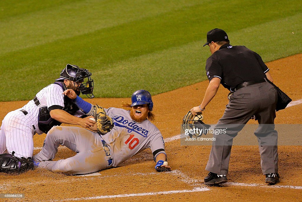 Justin Turner #10 of the Los Angeles Dodgers screams as he's tagged out by catcher Michael McKenry #8 of the Colorado Rockies as home plate umpire D.J. Reyburn makes the call during the sixth inning at Coors Field on September 16, 2014 in Denver, Colorado.