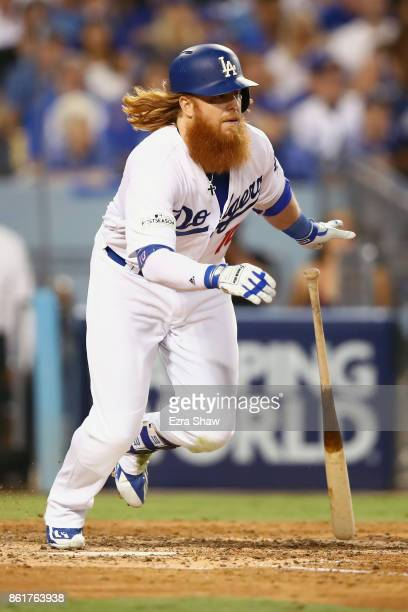 Justin Turner of the Los Angeles Dodgers singles in the bottom of the fifth inning during Game Two of the National League Championship Series against...