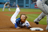 Justin Turner of the Los Angeles Dodgers steals third base in the third inning against the New York Mets in game five of the National League Division...