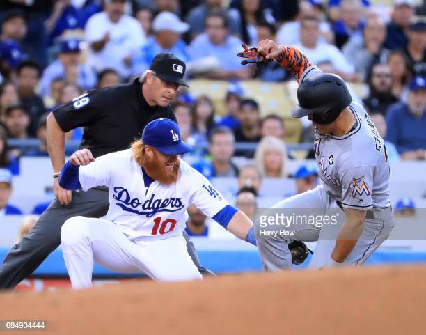 Justin Turner of the Los Angeles Dodgers tags out Giancarlo Stanton of the Miami Marlins at third base on a steal attempt during the second inning at...