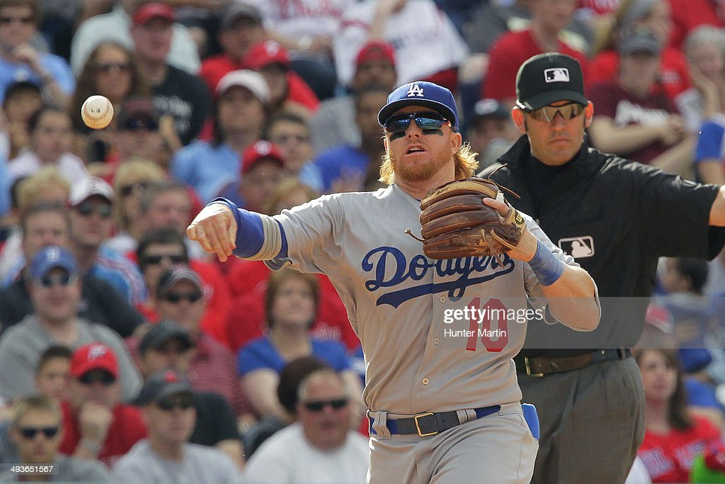 <a gi-track='captionPersonalityLinkClicked' href=/galleries/search?phrase=Justin+Turner&family=editorial&specificpeople=550296 ng-click='$event.stopPropagation()'>Justin Turner</a> #10 of the Los Angeles Dodgers throws to first base in the seventh inning during a game against the Philadelphia Phillies at Citizens Bank Park on May 24, 2014 in Philadelphia, Pennsylvania. The Phillies won 5-3.