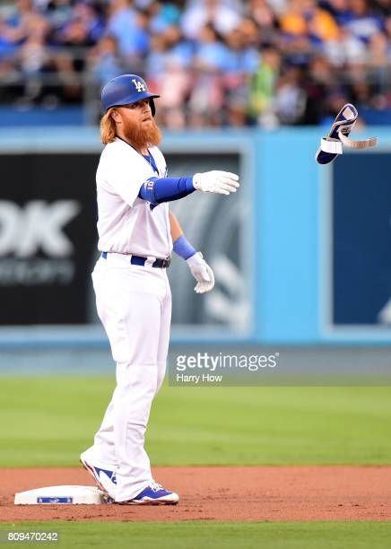 Justin Turner of the Los Angeles Dodgers tosses his shin guard after his double during the first inning against the Arizona Diamondbacks at Dodger...