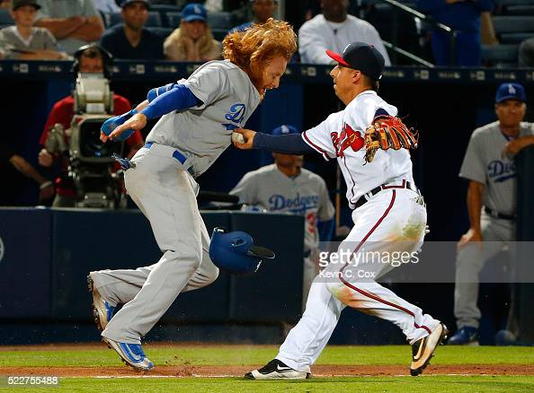 Justin Turner of the Los Angeles Dodgers was tagged out in a rundown by Daniel Castro of the Atlanta Braves down the third base line in the 10th...