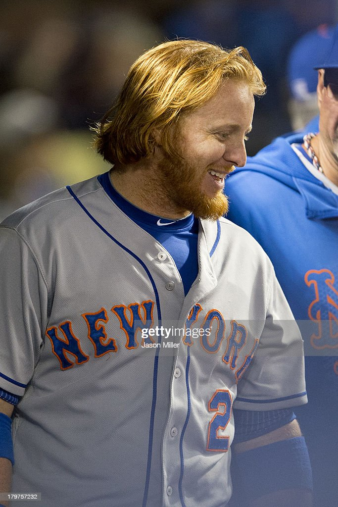 <a gi-track='captionPersonalityLinkClicked' href=/galleries/search?phrase=Justin+Turner&family=editorial&specificpeople=550296 ng-click='$event.stopPropagation()'>Justin Turner</a> #2 of the New York Mets celebrates in the dugout after hitting a solo home run during the seventh inning against the Cleveland Indians at Progressive Field on September 6, 2013 in Cleveland, Ohio.