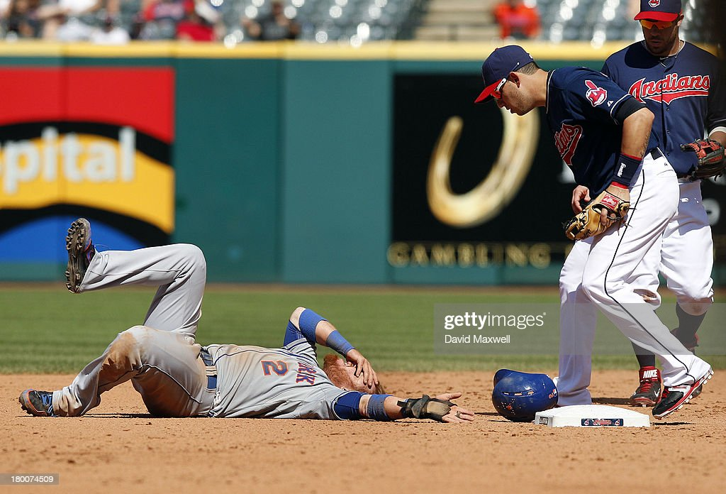 <a gi-track='captionPersonalityLinkClicked' href=/galleries/search?phrase=Justin+Turner&family=editorial&specificpeople=550296 ng-click='$event.stopPropagation()'>Justin Turner</a> #2 of the New York Mets is injured after attempting to steal second base against <a gi-track='captionPersonalityLinkClicked' href=/galleries/search?phrase=Asdrubal+Cabrera&family=editorial&specificpeople=834042 ng-click='$event.stopPropagation()'>Asdrubal Cabrera</a> #13 of Cleveland Indians in the fifth inning of their game on September 8, 2013 at Progressive Field in Cleveland, Ohio. The Mets defeated the Indians 2-1.