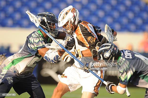 Justin Turri of the Rochester Rattlers trys to get through Mark McNeill and Brian Cooper of the Chesapeake Bayhawks during a Major League Lacrosse...