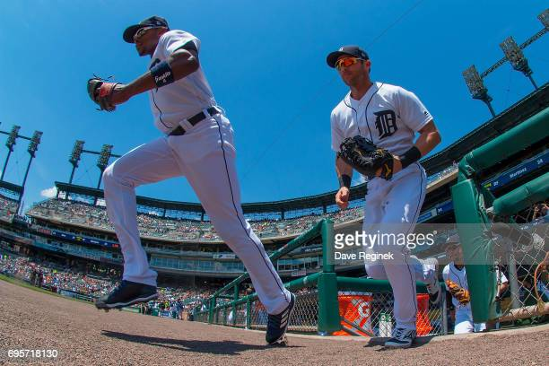 Justin Upton and Andrew Romine of the Detroit Tigers head out to the field before the start of a MLB game against the Los Angeles Angels of Anaheim...