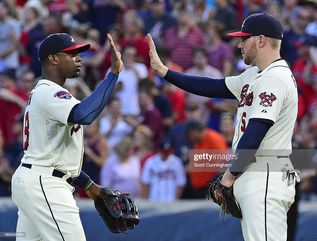 <a gi-track='captionPersonalityLinkClicked' href=/galleries/search?phrase=Justin+Upton&family=editorial&specificpeople=846265 ng-click='$event.stopPropagation()'>Justin Upton</a> #8 and <a gi-track='captionPersonalityLinkClicked' href=/galleries/search?phrase=Freddie+Freeman&family=editorial&specificpeople=5743987 ng-click='$event.stopPropagation()'>Freddie Freeman</a> #5 of the Atlanta Braves celebrate after the game against the Miami Marlins at Turner Field on August 31, 2014 in Atlanta, Georgia.